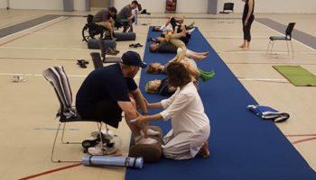 WNY Adaptive Rec Expo 2017 Yoga Class - People lying on yoga mats