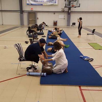 WNY Adaptive Rec Expo 2017 Yoga Class - People lying on yoga mats